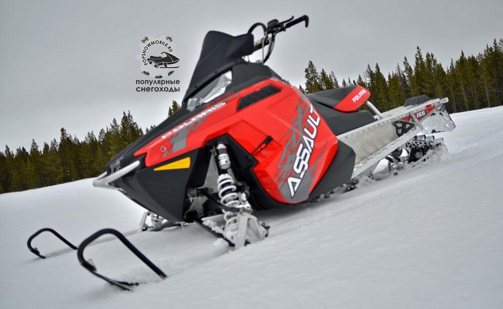 Собираетесь гонять в горах? Возьмите Polaris RMK Assault с гоночным траком, ставший по нашему мнению лучшим снегоходом для горных гоночных заездов.